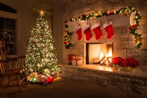 christmas glowing fireplace hearth tree red stockings gifts and decorations