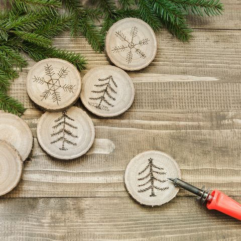 Christmas homemade pyrography toys. Wooden slice. Alternative decor. Christmas decorations. Close up.