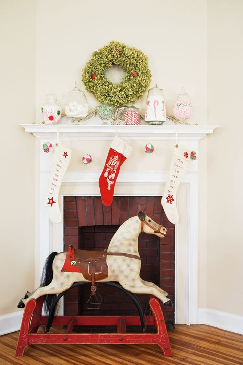 christmas fireplace display with rocking horse