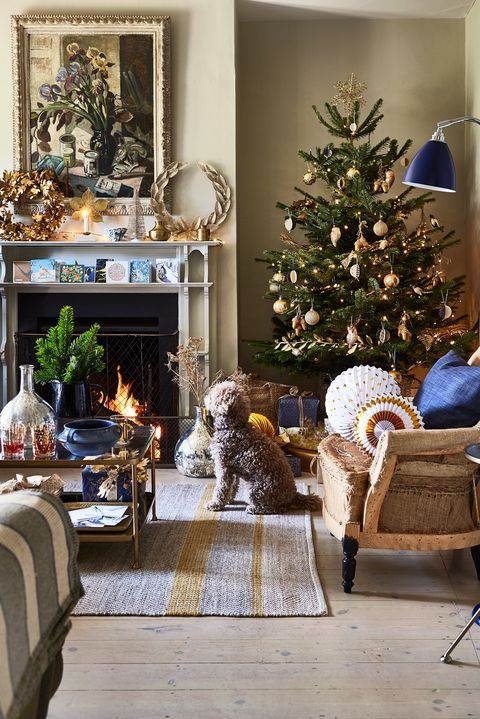 living room decorated in gold for christmas