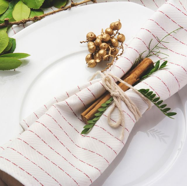 red and white striped napkin on holiday place setting
