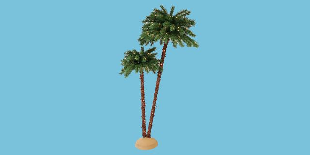 christmas palm tree display with light blue background