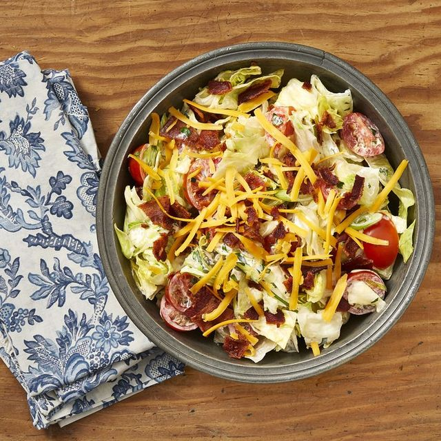 christmas salads ranch salad on wood background with blue and white napkin