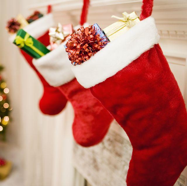 christmas stockings hanging by christmas tree
