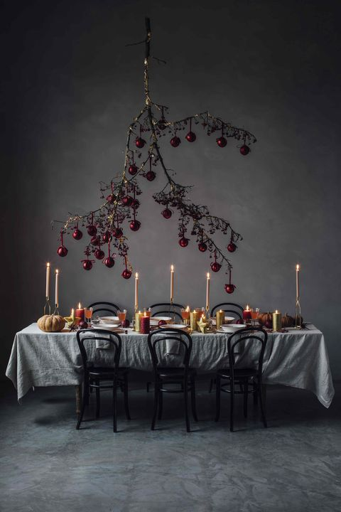 christmas dining table with branch and baubles
