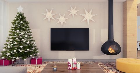 christmas theme decorated apartment interior with tv set