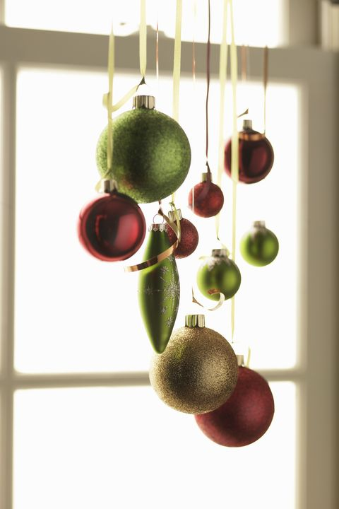 christmas ornaments hanging in living room close up