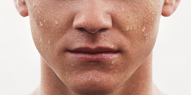 lower half of face young man sweating