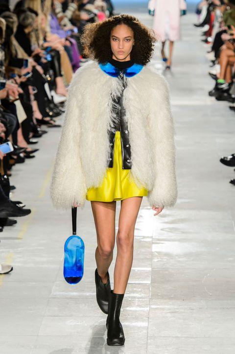 Fashion model, Fashion show, Fashion, Fur, Clothing, Fur clothing, Street fashion, Runway, Electric blue, Yellow,