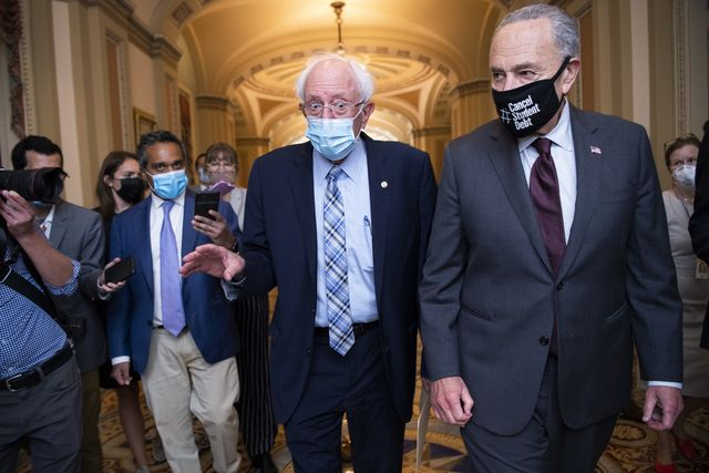 united states   august 9 senate majority leader charles schumer, d ny, right, and sen bernie sanders, i vt, are seen in the us capitol on monday, august 9, 2021 photo by tom williamscq roll call
