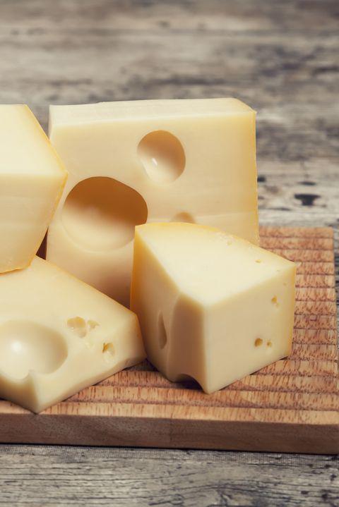 Chunks of Maasdam Dutch cow's milk cheese