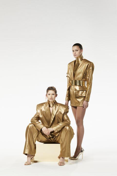 Fashion, Sitting, Standing, Photography, Fashion model, Fashion design, Beige, Photo shoot, Costume,