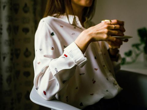White, Hand, Sleeve, Outerwear, Textile, Figurine, Fashion accessory, Top,