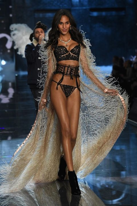 Hairstyle, Fashion show, Human leg, Runway, Fashion model, High heels, Style, Dress, Thigh, Model,