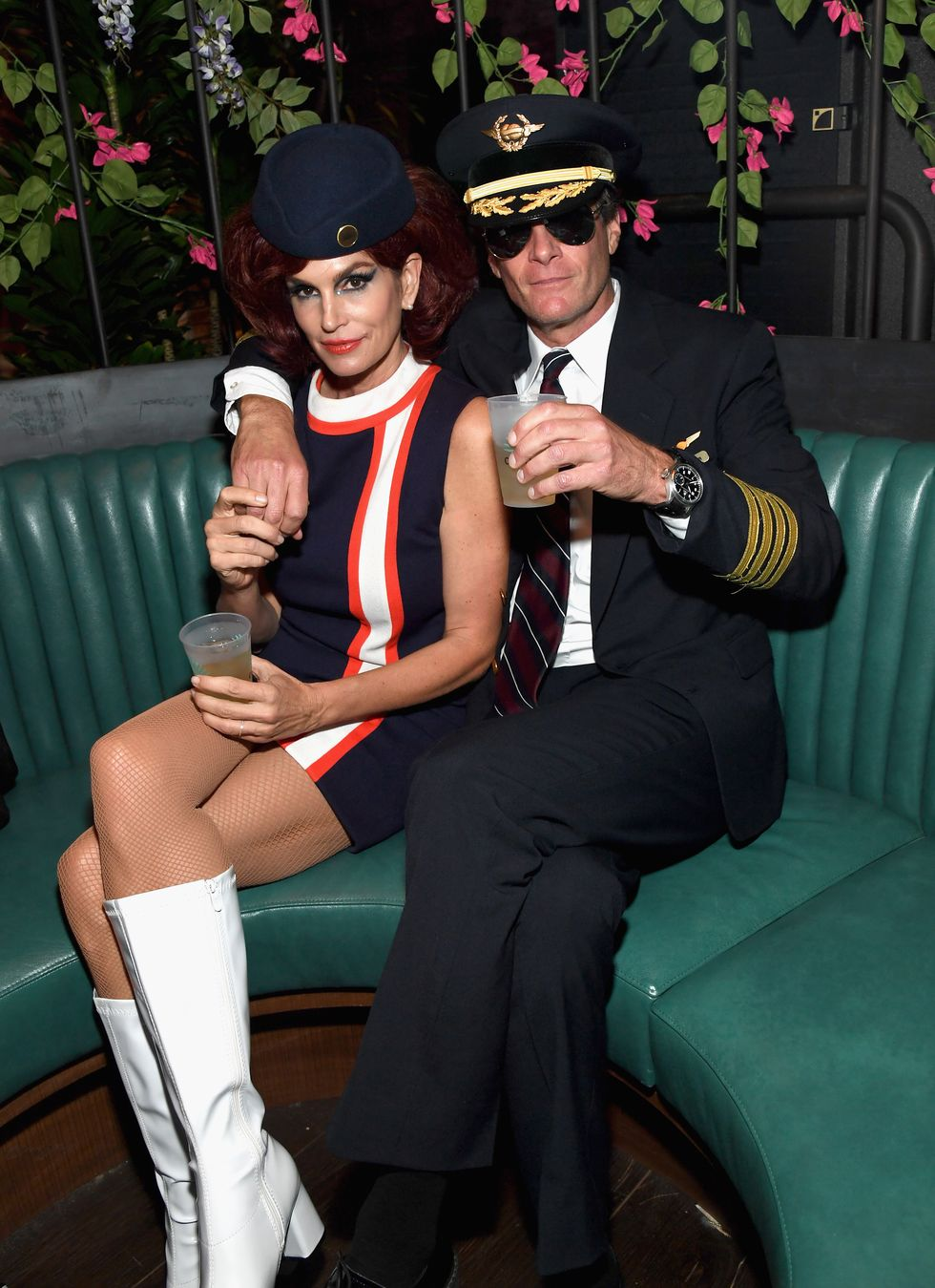 Cindy Crawford and Rande Gerber - Flight Attendant and Pilot Cozied up at one of two Casamigos Halloween parties in 2018, Cindy Crawford made an old-school flight attendant's uniform look überstylish, while her hubs Rande Gerber (a Casamigos cofounder) rocked a pilot outfit. (P.S. George Clooney joined in as a pilot, too.