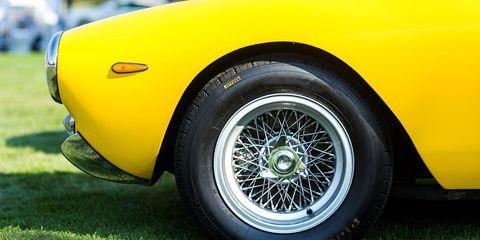 Land vehicle, Vehicle, Car, Wheel, Yellow, Coupé, Alloy wheel, Automotive wheel system, Tire, Auto part,