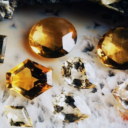 Yellow, Amber, Astronomical object, Natural material, Gemstone, Mineral, Quartz, Crystal, Brass,