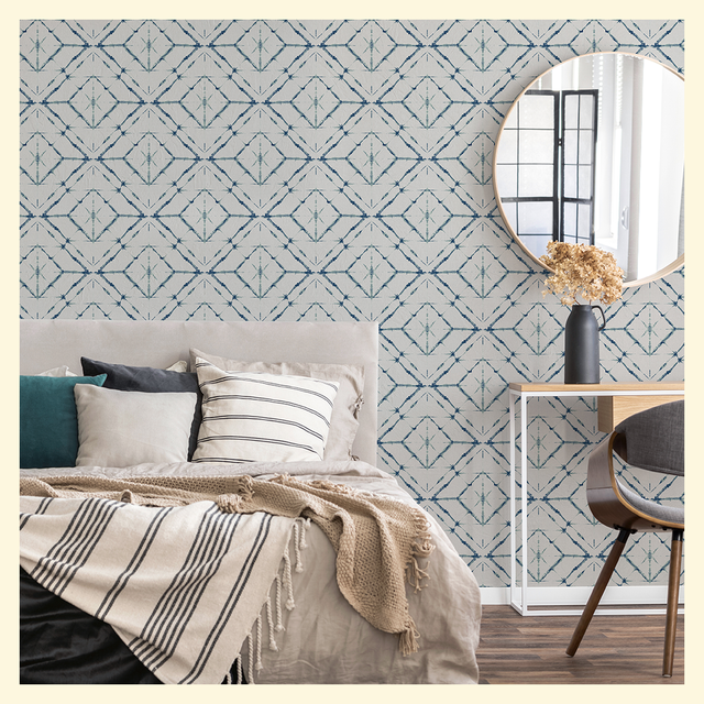 bedroom with geometric wallpaper