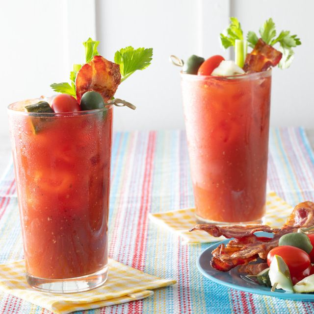 classic bloody mary two glasses with garnishes on plate