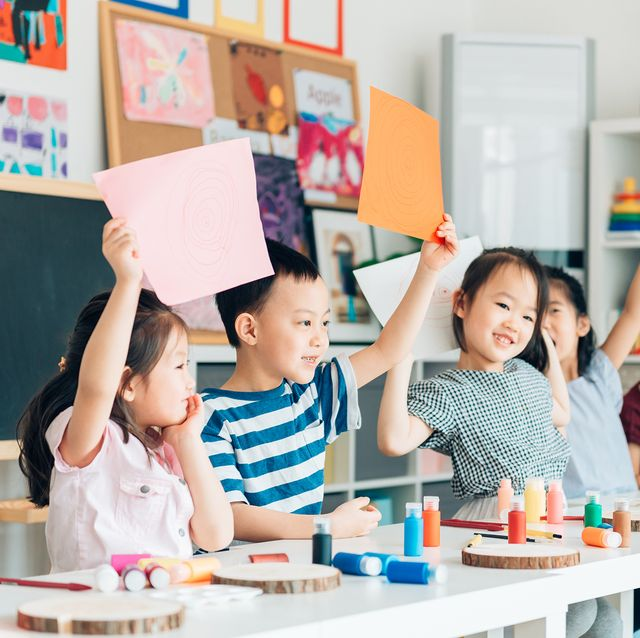 young kids in a colorful classroom
