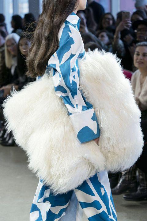 Fur, Fur clothing, Fashion, Clothing, Street fashion, Blue, Haute couture, Fashion show, Textile, Feather,