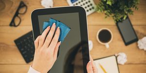 Woman cleaning a tablet - tech cleaning tips