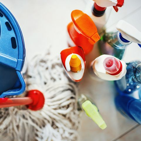 cleaning products and mop and bucket on floor