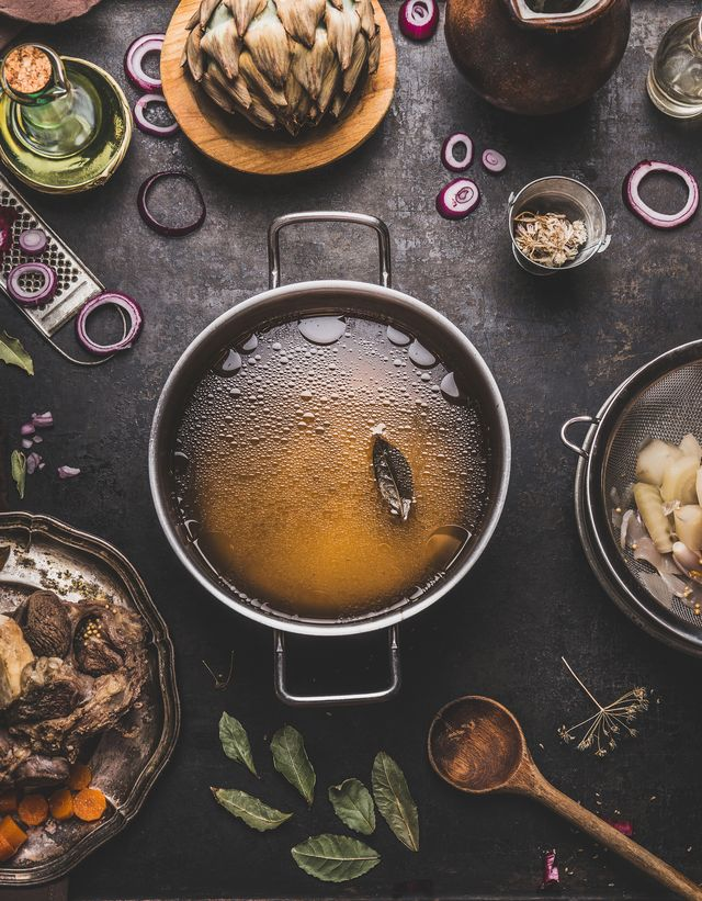 clear beef bone broth or stock in cooking pot