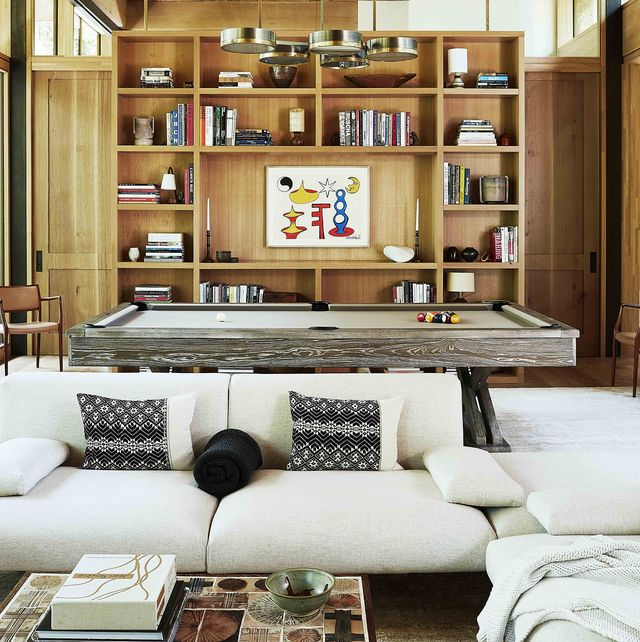 sofa, pool table, and bookshelves in great room