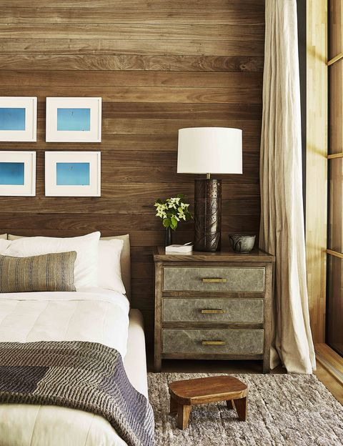 guest room with bed and nightstand and paneled wall