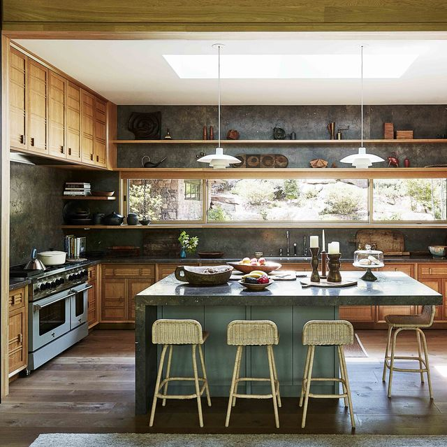 kitchen with green island and limestone countertops