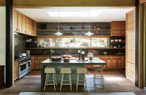kitchen with wood cabinets green island and limestone countertop