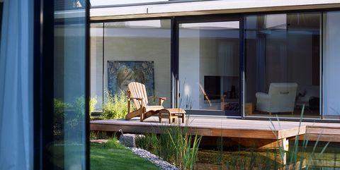 Imagen de casa exterior con ventanas Climalit