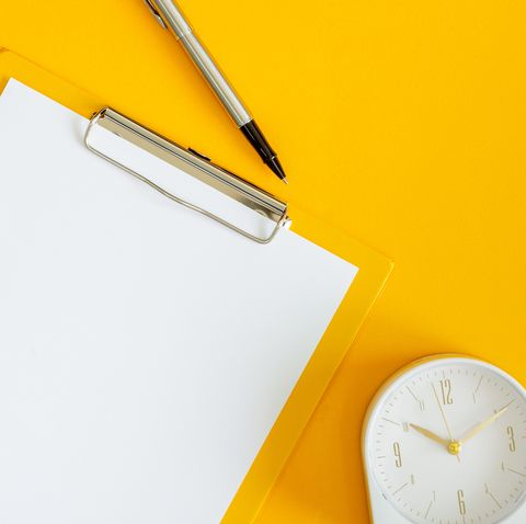 clipboard and clock on yellow background