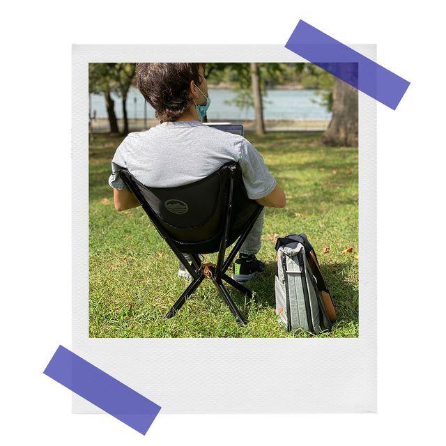 stefan sittting on cliq portable chair in park