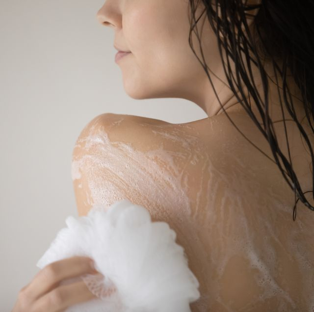 close up beautiful young woman taking shower in bathroom