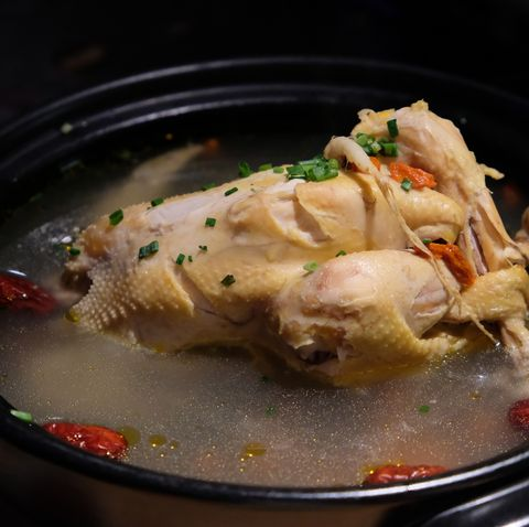 close up ginseng chicken soup in black pot famous cuisine in china and korea