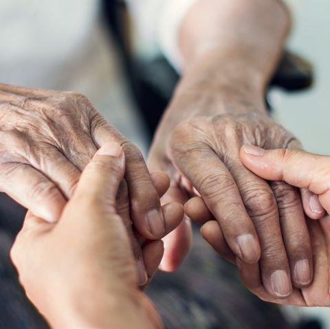 close up hands of helping hands elderly home care mother and daughter mental health and elderly care concept