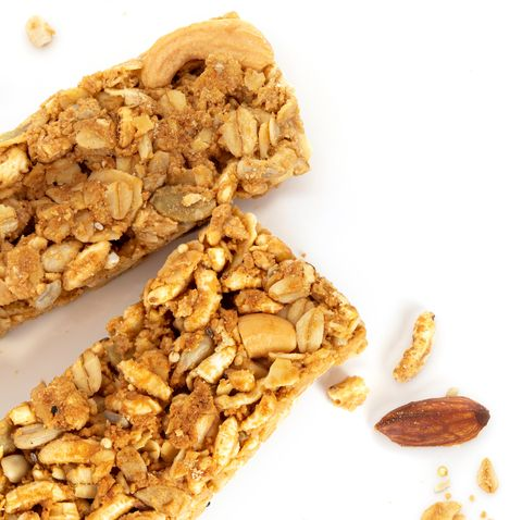 close up homemade healthy granola crunchy biscuit bars , vegan friendly snack , a healthy food concept