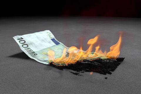 Close-Up Of 100 Euro Note Burning