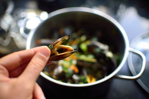 close up of a cooked mussel from pan