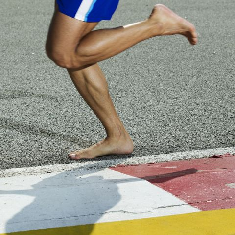 Close up of a runner's bare feet on the running track
