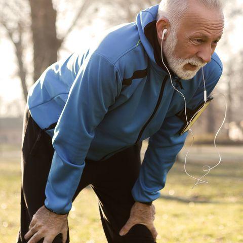 Close up of a senior man resting after jogging