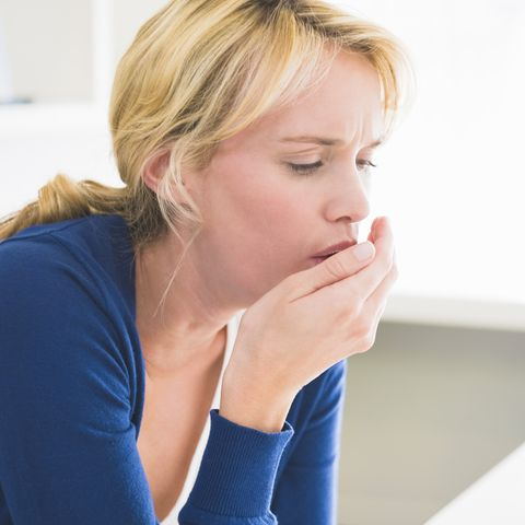 close up of a woman coughing