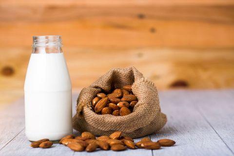 almonds և milk bottle on the table