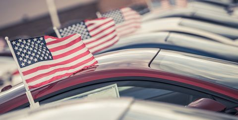 Close-Up Of American Flags On Cars