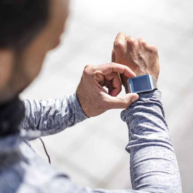close up of athlete checking smartwatch
