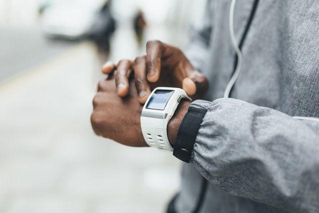 close up of athlete using smartwatch