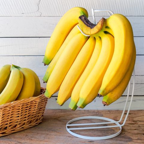 close up of bananas with basket on table