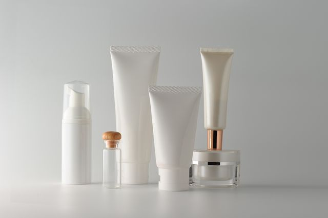 close up of beauty products against gray background
